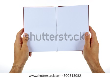 Male hands holding book isolated on white - stock photo