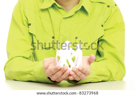 Male hands holding paper people, closeup, isolated on white - stock photo