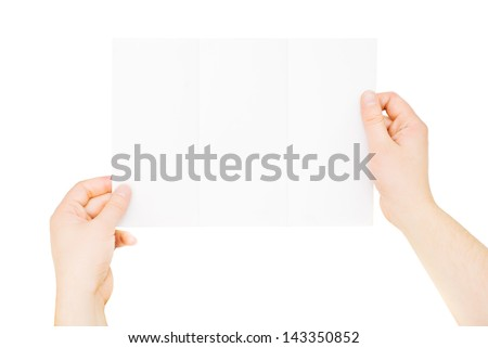 Male hands holding trifold blank brochure, isolated on white - stock photo