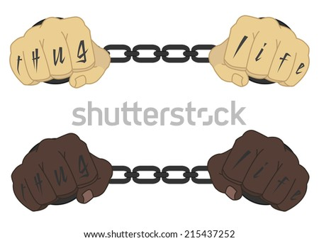 Male hands in steel handcuffs with Thug Life tattoo  - stock photo