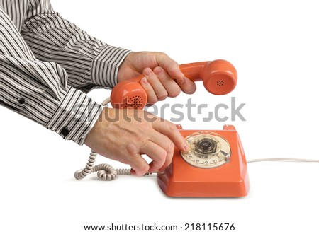 Male hands making phone call with vintage telephone, isolated on white - stock photo