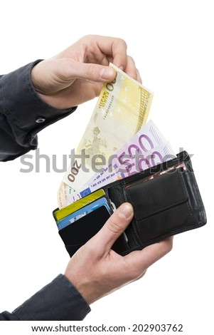 Male hands pulling out 200 hundred euro from the wallet isolated on white. Shallow depth of field. - stock photo