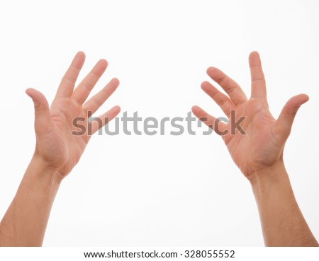 Male hands showing a gesture of a goodwill, white background - stock photo