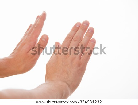 Male hands showing a rejection gesture - stock photo