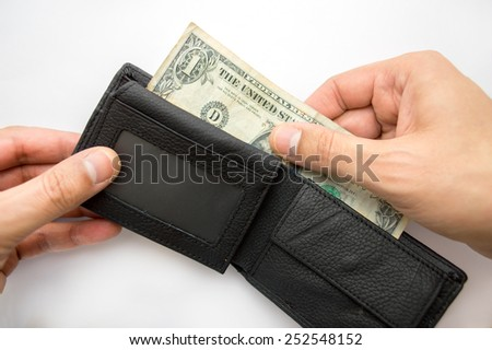 male hands taking out dollar from the wallet - stock photo