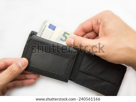 male hands taking out money from the wallet - stock photo