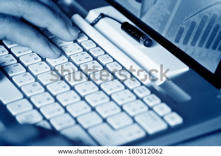 Male hands typing on computer keyboard - stock photo