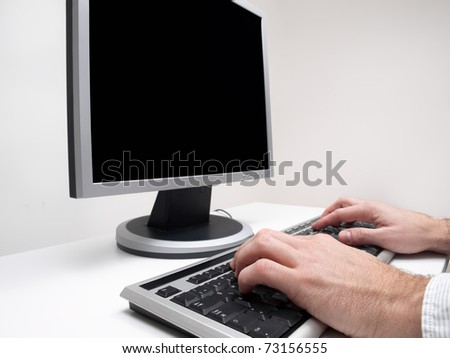 Male hands typing on the  computer keyboard with monitor black screen for copy space, for computing,internet,communication themes - stock photo