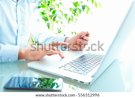 Male hands using laptopr and credit card. Online shopping