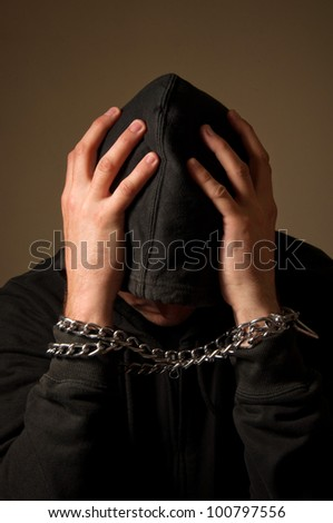 Male hands with chain wrapped around them, prisoner concept - stock photo