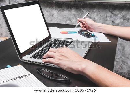 Male hands working on laptop with document. Concepts for business analysis, consulting, teamwork, project management, financial report and strategy.