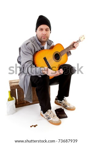 male homeless tramp with guitar over white background - stock photo
