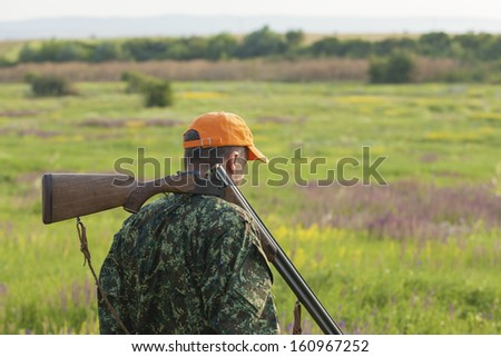 Male hunter looking at field