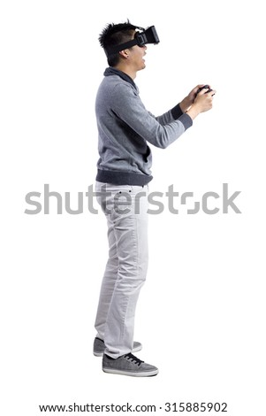 Male immersed in interactive virtual reality video game doing gestures on white background.  He is wearing a stereoscopic 3d vr headset. - stock photo