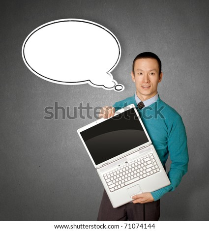 Male in blue with open laptop in his hands and comics bubble - stock photo