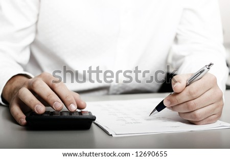 male in white shirt completing a blank form - stock photo