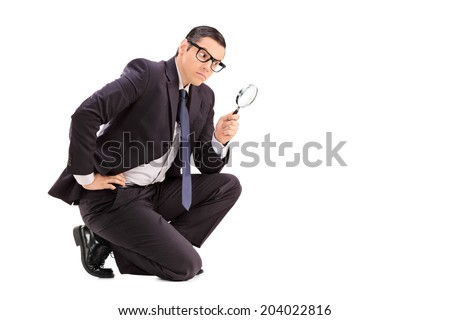 Male inspector looking through a magnifying glass isolated on white background