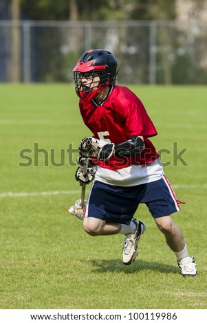 Male Lacrosse Player - stock photo