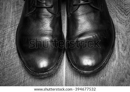 male leather shoes on wooden background - stock photo