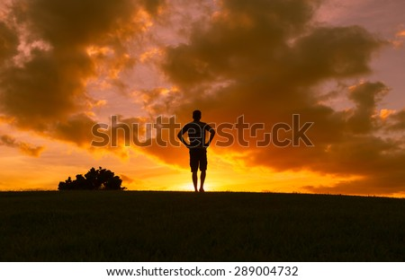 Male looking out towards the horizon.  - stock photo