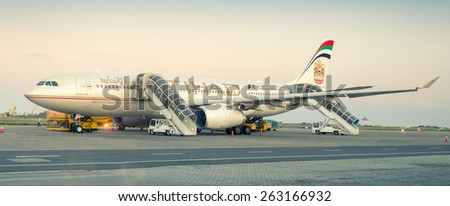 MALE, MALDIVES - FEBRUARY 10, 2015: Etihad Airbus 330 ready to take off. Etihad is the flag carrier airline of the United Arab Emirates with its headquarters in Abu Dhabi. - stock photo