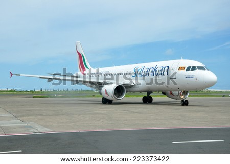 MALE, MALDIVES - SEPTEMBER 4, 2014: A SriLankan Airlines Airbus A320 at Ibrahim Nasir International Airport. SriLankan Airlines is the flag carrier of Sri Lanka. - stock photo