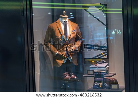 Male mannequin wearing a suit and accessories. Sale