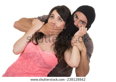 male masked thief kidnapping young girl isolated on white - stock photo