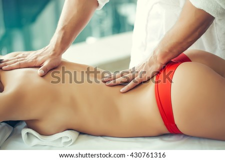 Masseur Moves His Hands Close To Buttocks