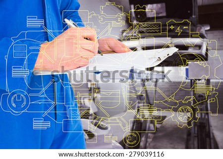 Male mechanic writing on clipboard against auto repair shop - stock photo