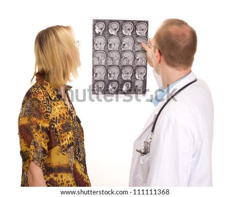 Male medical doctor examining a female patient