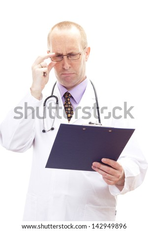Male medical physician looking worried on patients record - stock photo