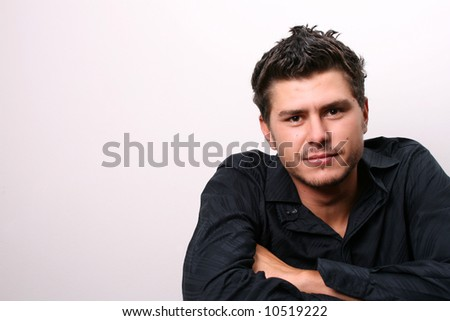 Male model in studio against white wall - stock photo