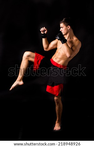 Male model. Kickboxing. Located on the back background. - stock photo