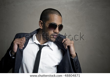 Male model poses as he looks outward - stock photo