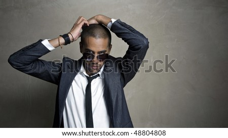 Male model poses for the camera with his sexy look - stock photo