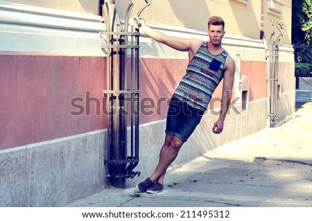 Male model posing on street - stock photo