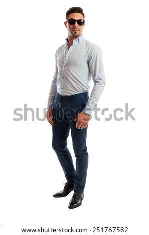 Male model wearing casual business clothes and shades on white background - stock photo