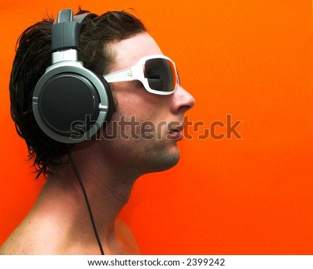 male model with headphones, (side view) - stock photo