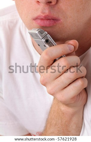 Male mouth and dictaphone. Close-up - stock photo