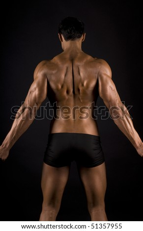 male muscular back on black background. - stock photo
