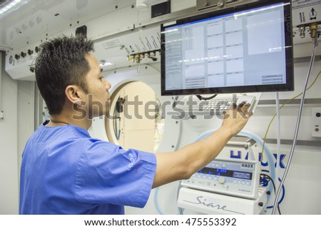 MALE NURSE  IN HYPERBARIC CHAMBER BANGKOK THAILAND AUGUST 25, 2016 : A male nurse  open pneumatic control  hyperbaric chamber  at Navy hospital Bangkok Thailand , August 25, 2016