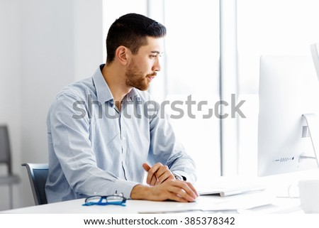 Male office worker sitting at desk