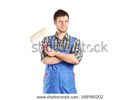 Male painter holding a paint roller isolated on white background