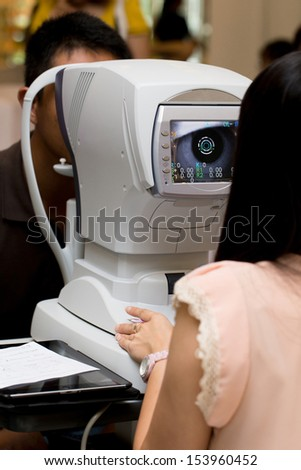 Male patient is having a medical attendance at the eye measuring - stock photo