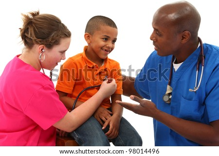 Male Pediatrician and Nurse Performing An Exam On Young Black Child - stock photo
