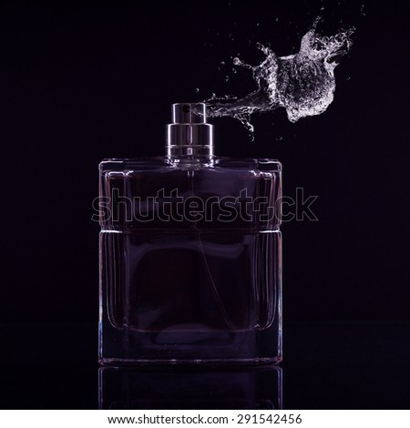 Male perfume bottle on a dark background.