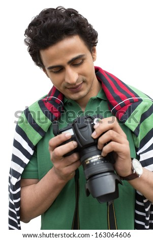 Male photographer holding a camera - stock photo