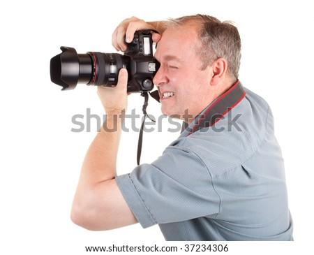 Male Photographer Shooting Something - stock photo