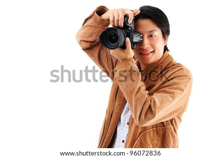 Male photographer with his camera isolated on white background - stock photo
